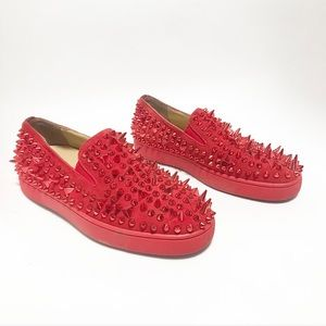 Red spike CL slip on sneakers.